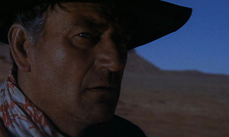 the searchers 1956 essay John ford's the searchers (1956) opens with the arrival of ethan edwards (john wayne) at his brother's home in southern texas, three years after the civil war has ended what appears to be a friendly and welcome family visit soon takes on sinister overtones when ethan's nephew asks him about the.